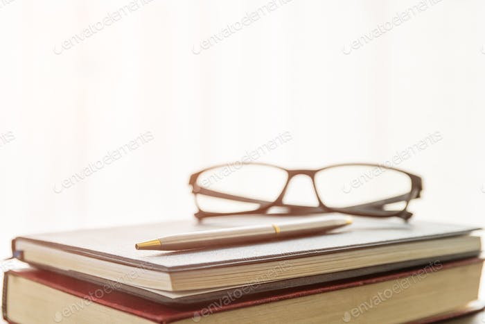Glasses and book on the desk-3