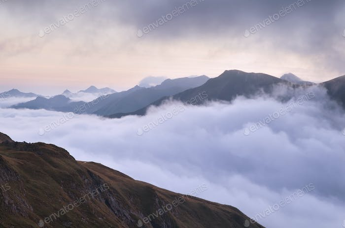 mountain range in morning fog