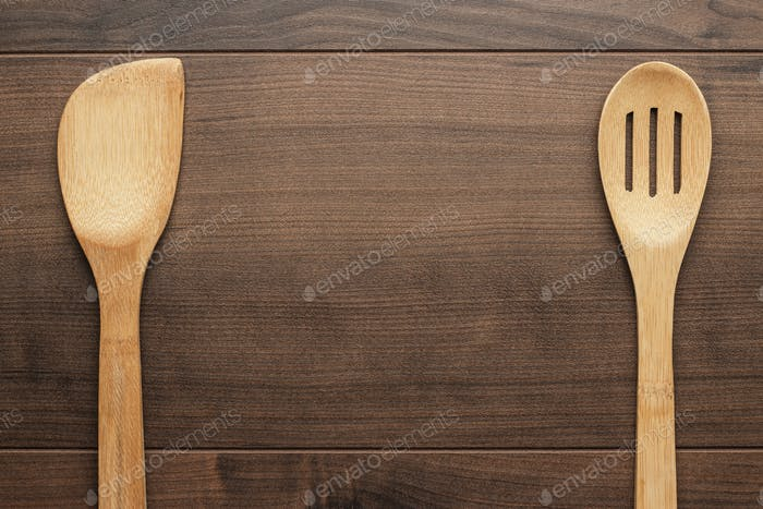 Wooden Skimmer And Spatula On The Table