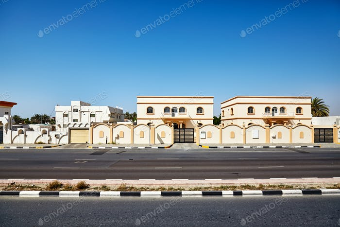 Road from Dubai to Sharjah with typical architecture, UAE.