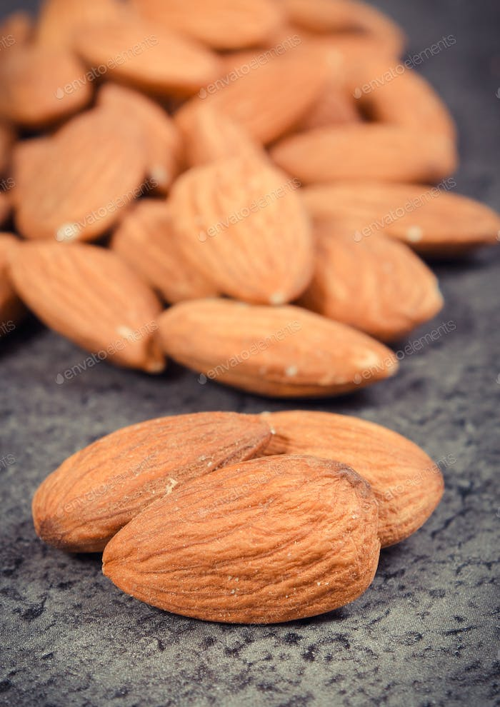 Almonds as source minerals and fiber. Wooden background