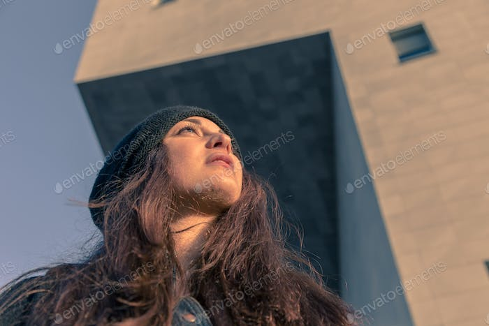 Beautiful young woman posing in the city streets