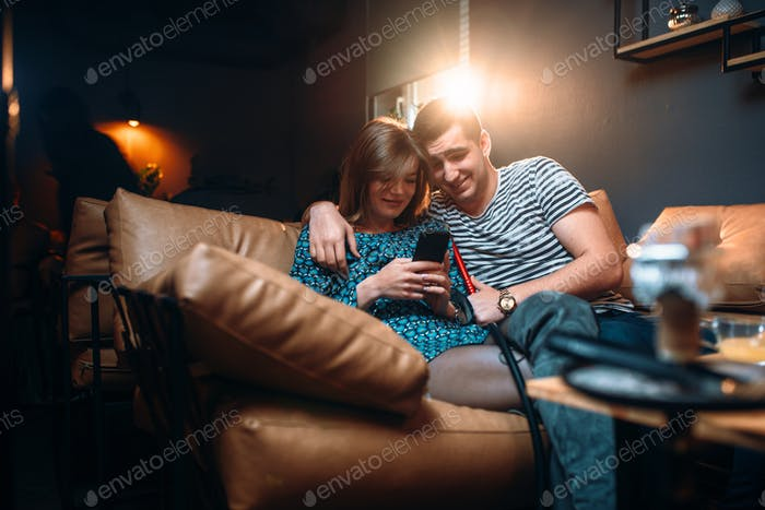 Love couple leisure, relaxation and smokes hookah