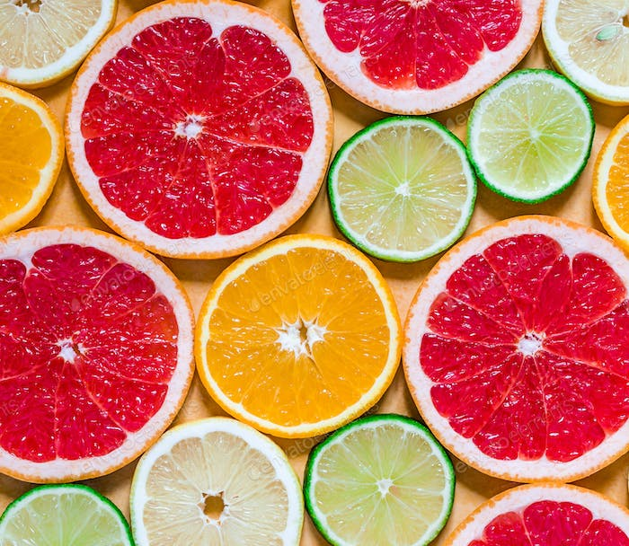Slices of various citrus fruits