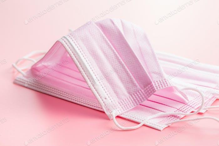 Corona virus protection. Pink medical paper face masks