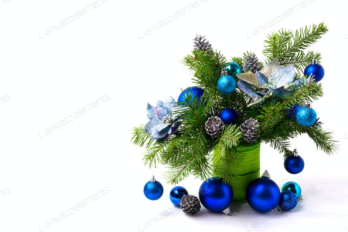 Christmas arrangement silk poinsettias, blue baubles, copy space