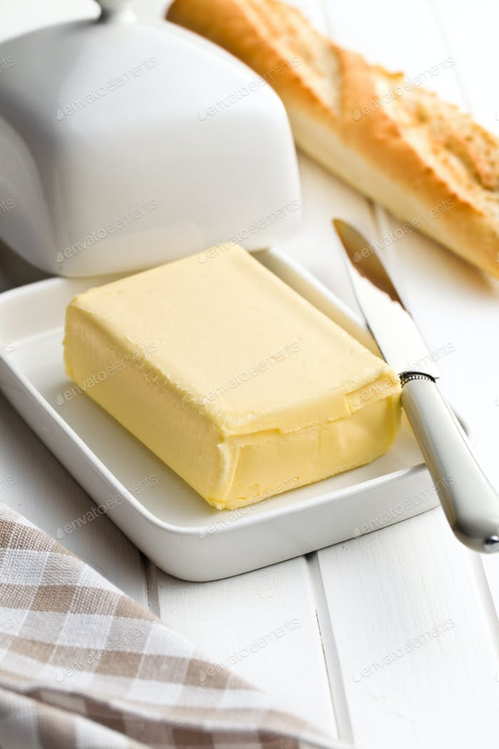 cube of butter with bread