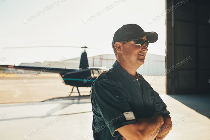 Helicopter pilot in airplane hangar