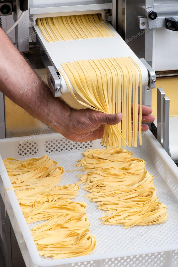 Chef making fresh tagliatelle pasta