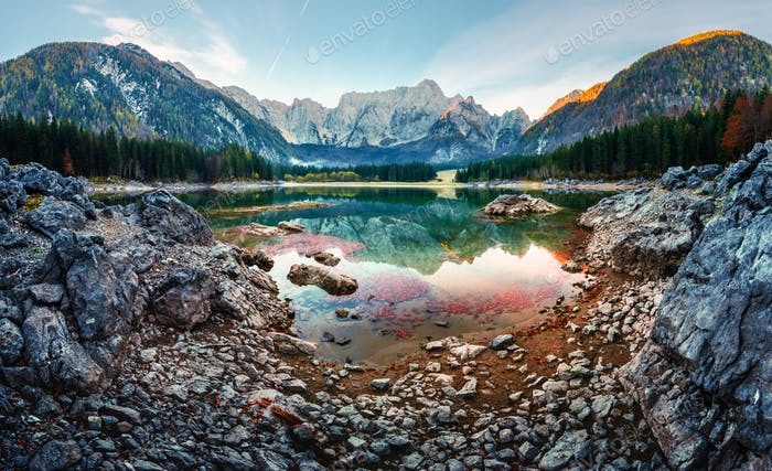 Colorful sunrise on Fusine lake