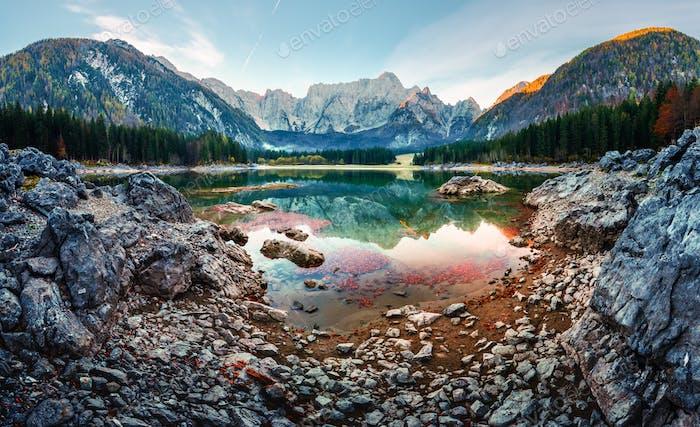 Colorful sunrise on Fusine lake