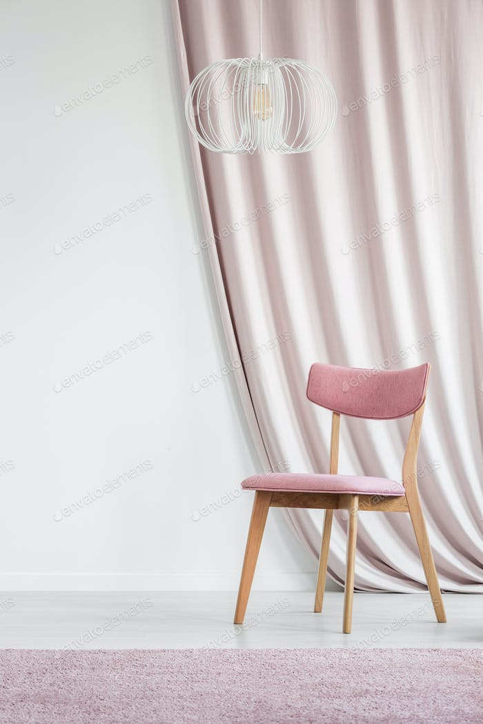 Pink room with empty wall