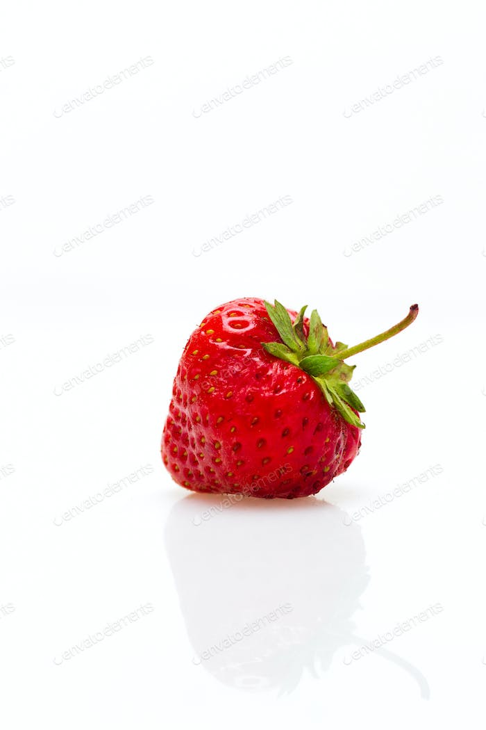 Berries of a strawberry on a white background