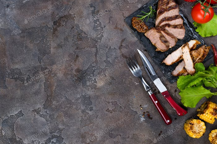 Fresh three types of grilled steak  on slate plate with herbs