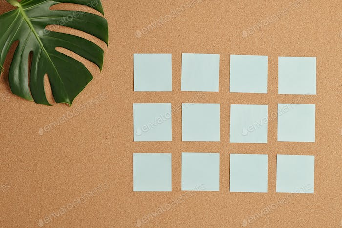 Flat layout of several rows of white blank notepapers on beige background
