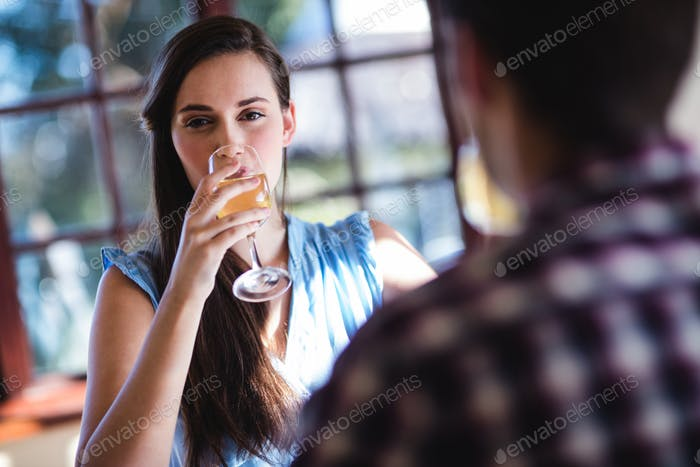 Young couple drinking white wine in restaurant