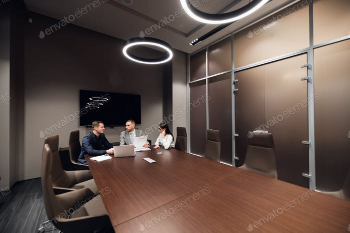 Coworkers meeting at conference room to discuss project in office