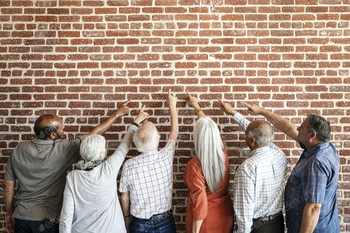 Old people facing the brick wall