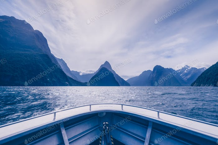 Milford sound peaks viewed from the boat in cold tone, New Zealand