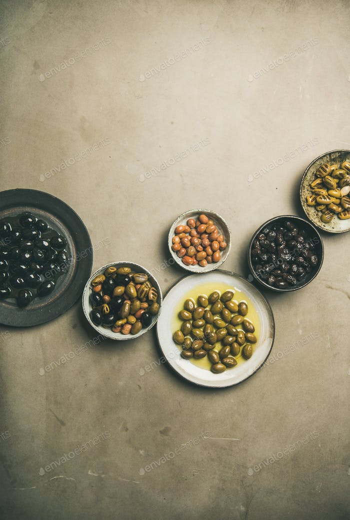 Various kinds of Mediterranean pickled olives in plates