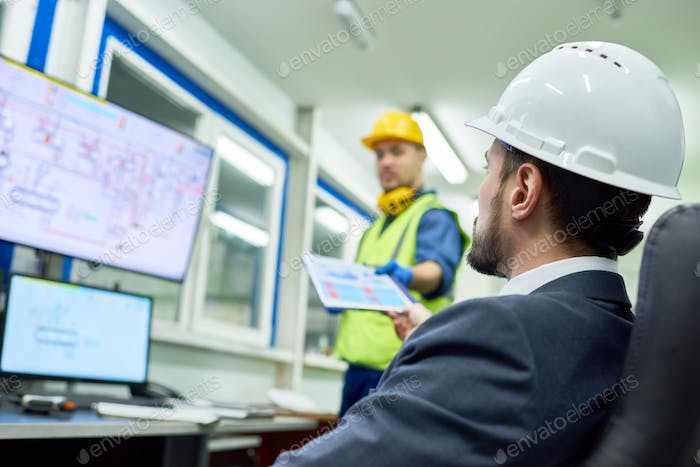 Businessman Overseeing Plant Production