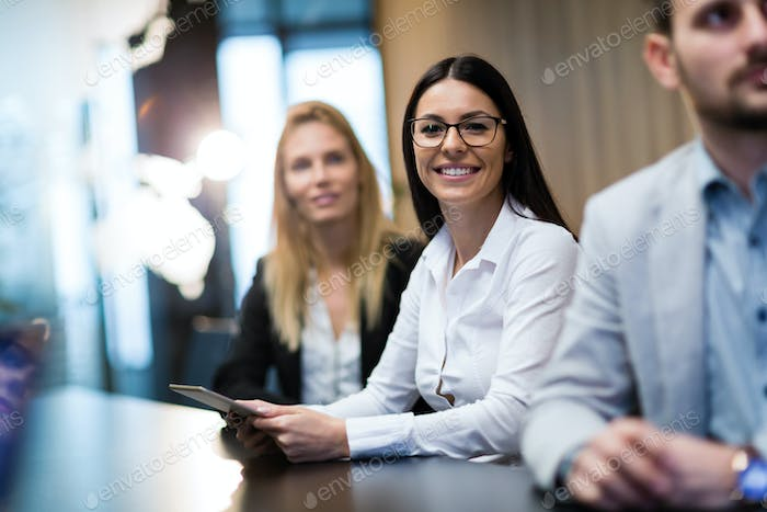 Portrait of smiling attractive businesswoman in office