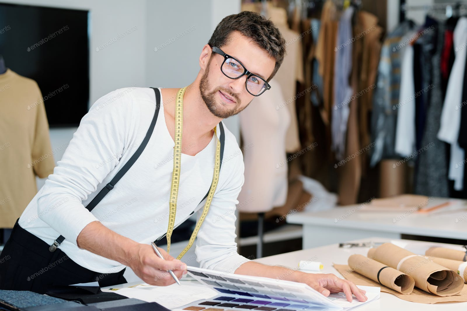 Young Professional Fashion Designer With Measuring Tape Looking At You Photo By Pressmaster On Envato Elements