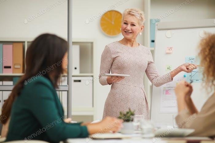 Elelgant Middle-Aged Woman Making Presentation