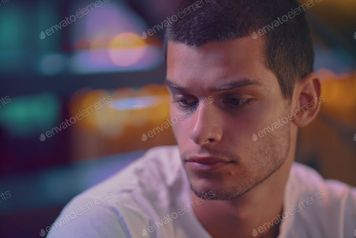 Close-up portrait of attractive male model. Young handsome man in a bar