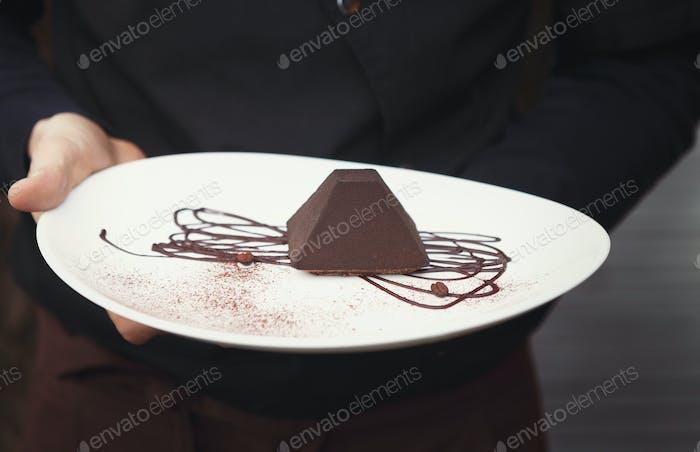 Chocolate truffle cake in pyramid shape