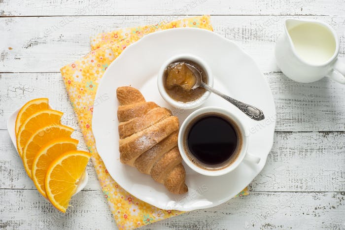 Thumbnail for Croissant jam coffee orange jice at white wooden table.