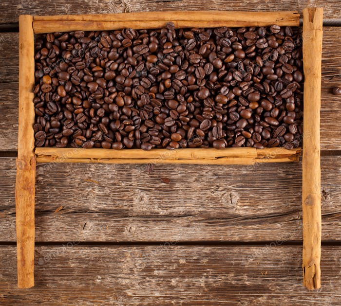Frame with coffee beans and ceylon cinnamon