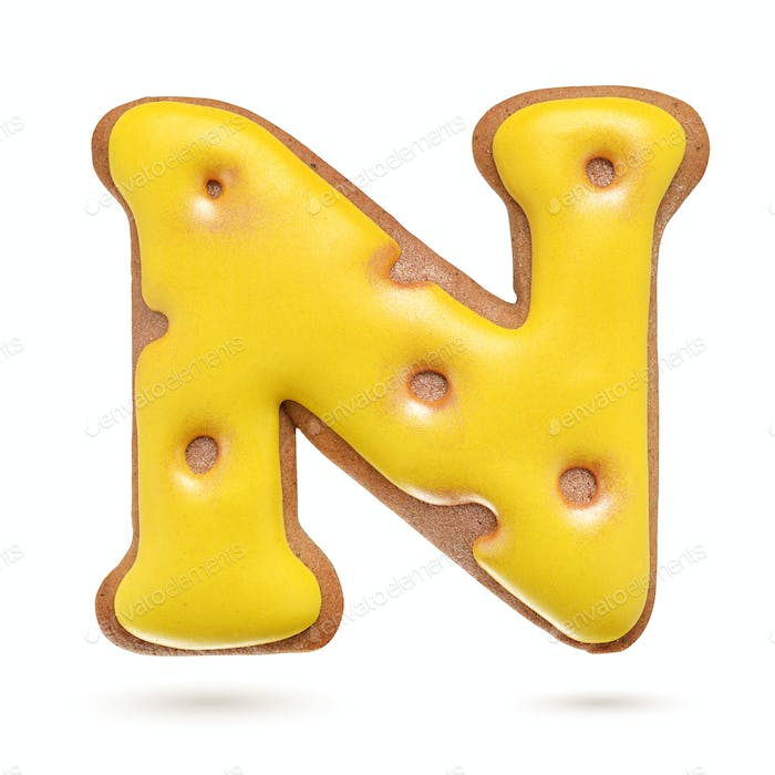 Capital letter N yellow gingerbread biscuit isolated on white.