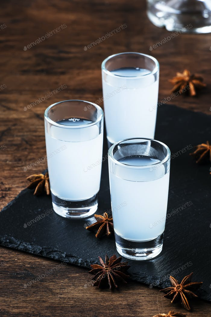 Ouzo - Greek anise brandy, traditional strong alcoholic drink in glasses