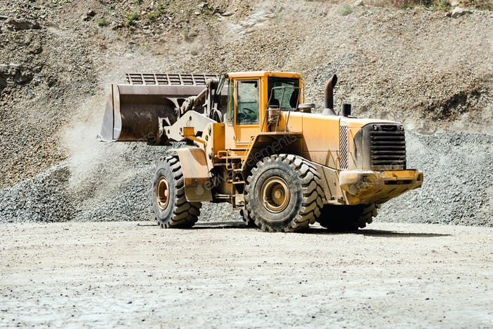 Wheel loader machinery bulldozer working on highway construction site