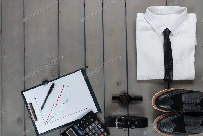 Businessman, work outfit on grey wooden background. White shirt with black tie, watch,