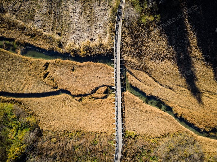 Wooden bridge over dry grassland,aerial view. Zelenci,Slovenia