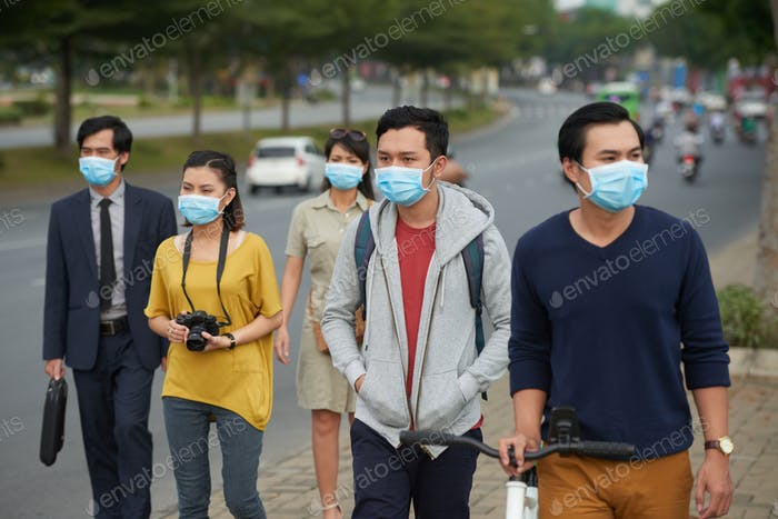 Asian people in medical masks