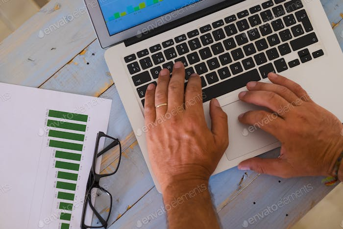 close up of hands of man on a laptop working hard to create an agency - business man