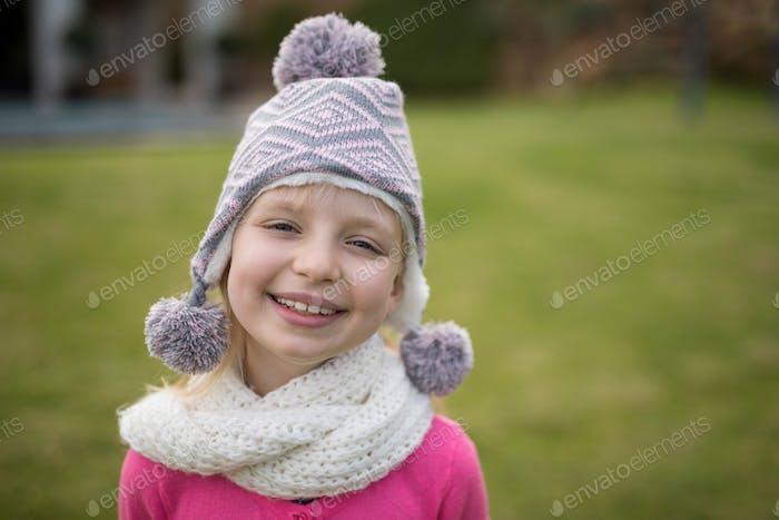 Smiling girl standing in the garden
