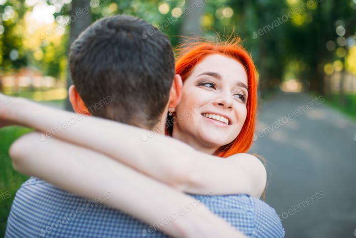 Romantic meeting, young couple hugs together