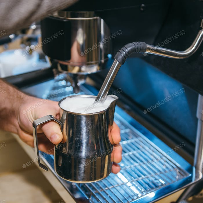 Making milk froth with espresso coffee machine