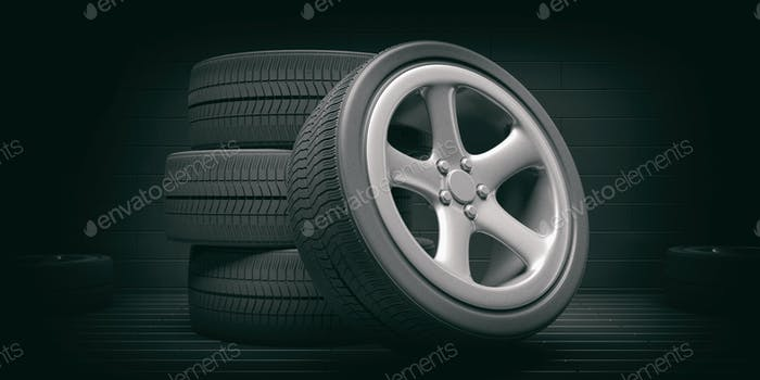 Car tires and rims on black background. 3d illustration