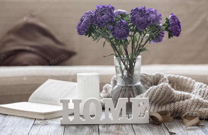 Cozy composition with blue chrysanthemums and the decorative word home.