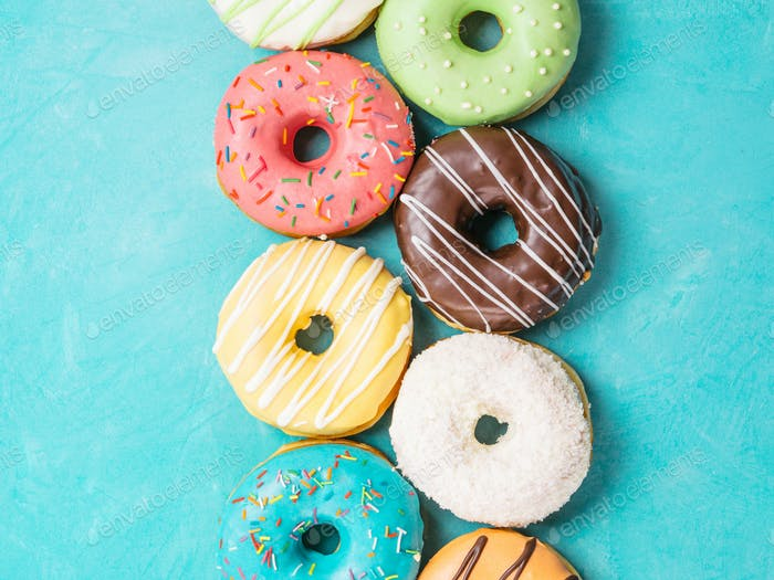 donuts on blue background, top view