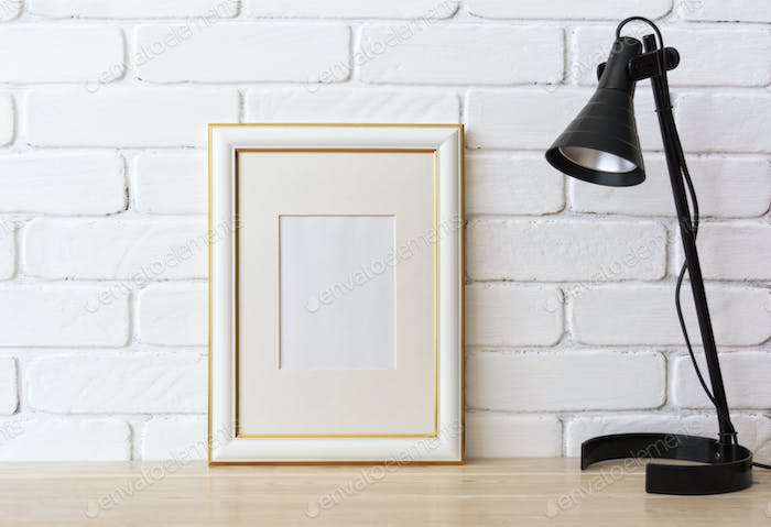 Gold decorated frame mockup with black lamp