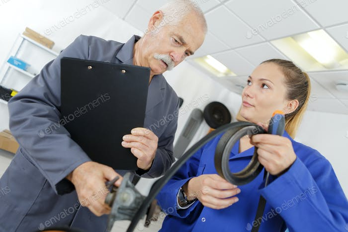 Apprentice showing length of rubber to tutor