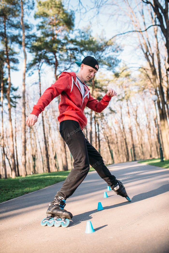 Roller skater, trick exercise in park