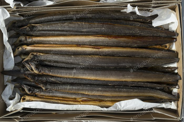 Fresh smoked eels in a cardboard box