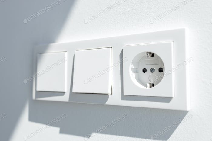 Modern White switch board with two switch and one european plug